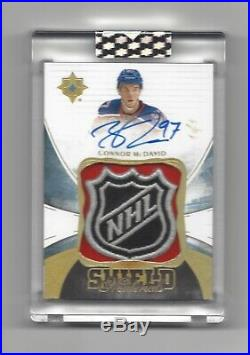 2016-17 Ultimate Collection Connor McDavid 2nd Year Game Used Shield Auto 1/1